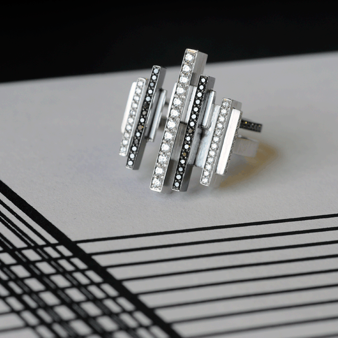 Art deco inspired ring on a black and white line drawing.