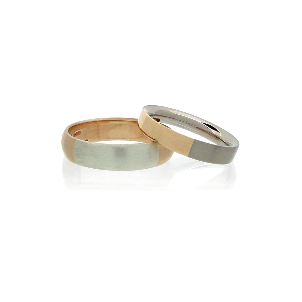 Two wedding rings in rose and white gold on a white background.