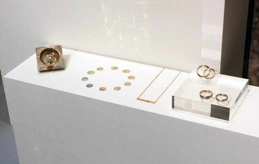 gold jewellery on white display