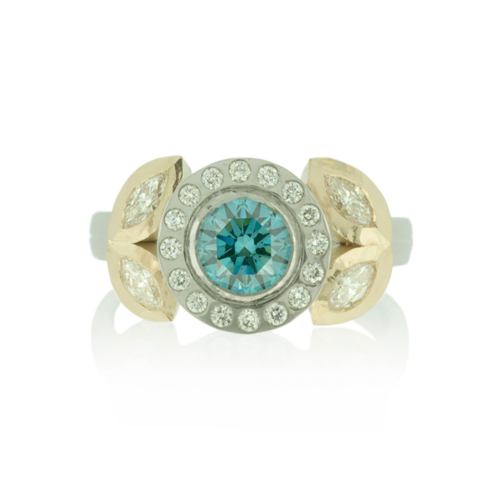 Diamond engagement ring in platinum and yellow gold on a white background.