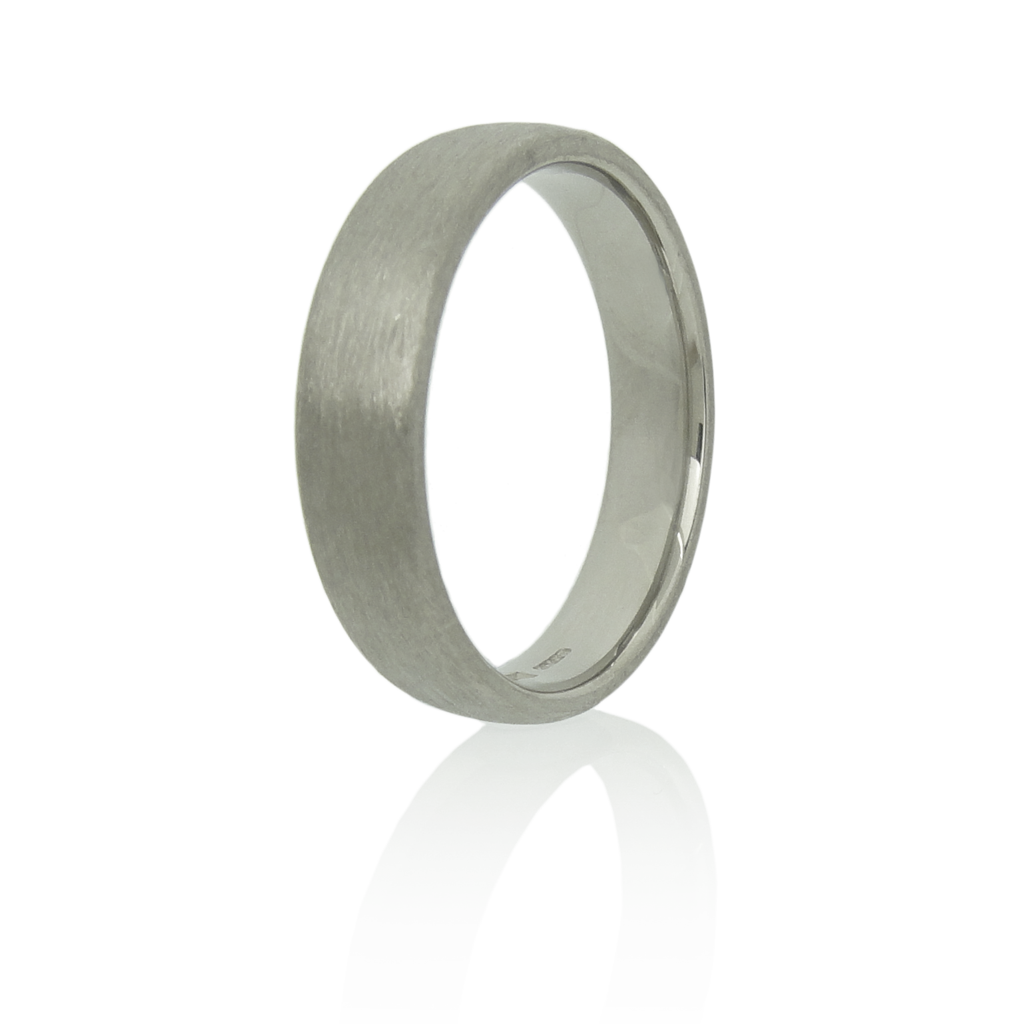 5mm wide 18k white gold ring with a brushed finish standing upright against a white background.