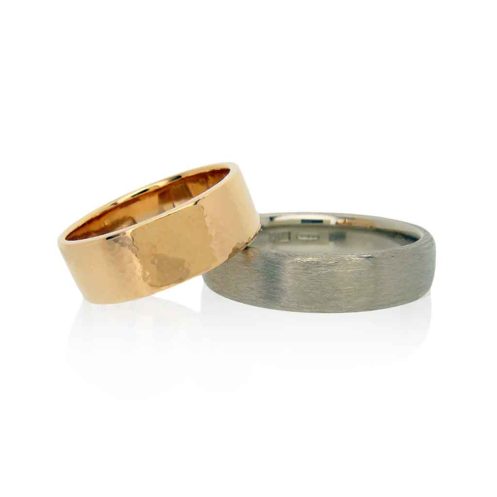 18k rose and white gold wedding bands with hammered and matte finishes on a white background.