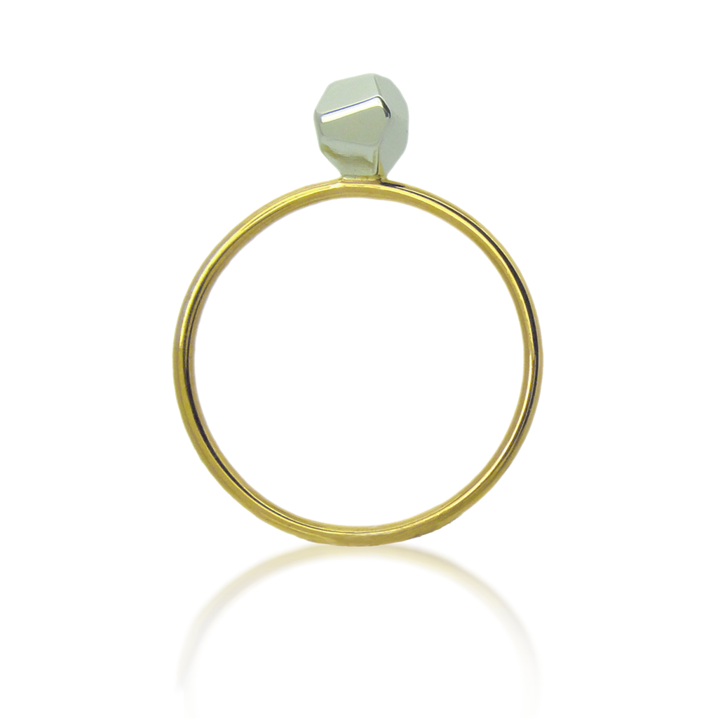 Upright Asteroid solitaire ring. Asteroid in white gold, the band in yellow gold on a white background.