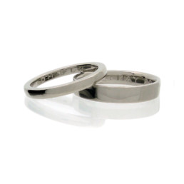 Fairtrade gold wedding rings with hand engraving. Made in London.