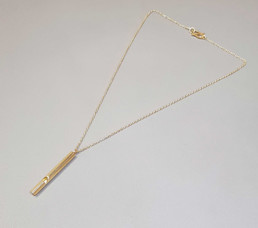 Gold whistle necklace