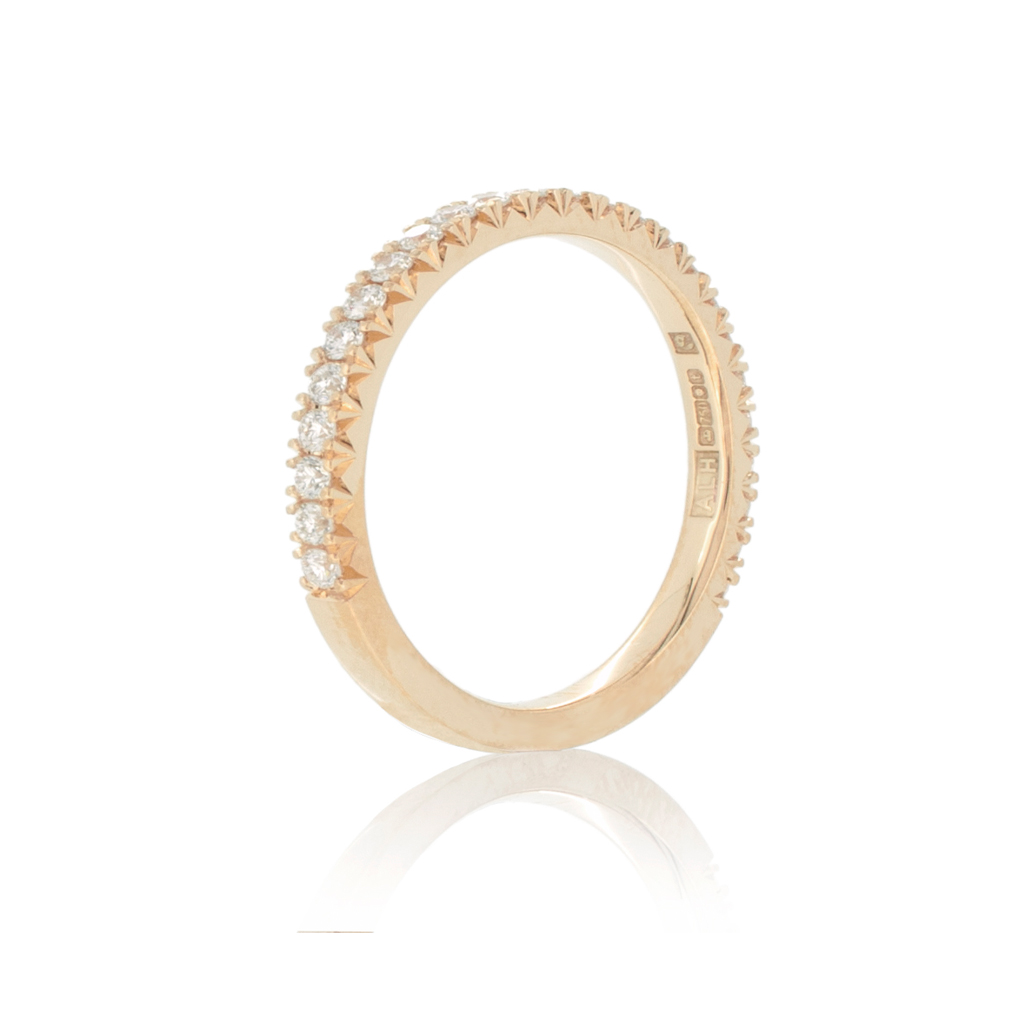 Diamond eternity band standing upright against a plain white background.