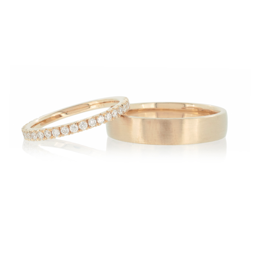 Diamond eternity ring and man's wedding band in light rose gold