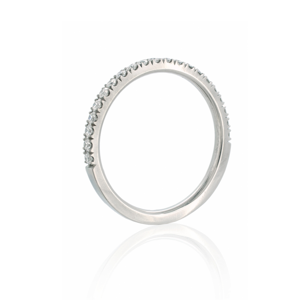 Castle set diamond eternity band standing upright on a white background.