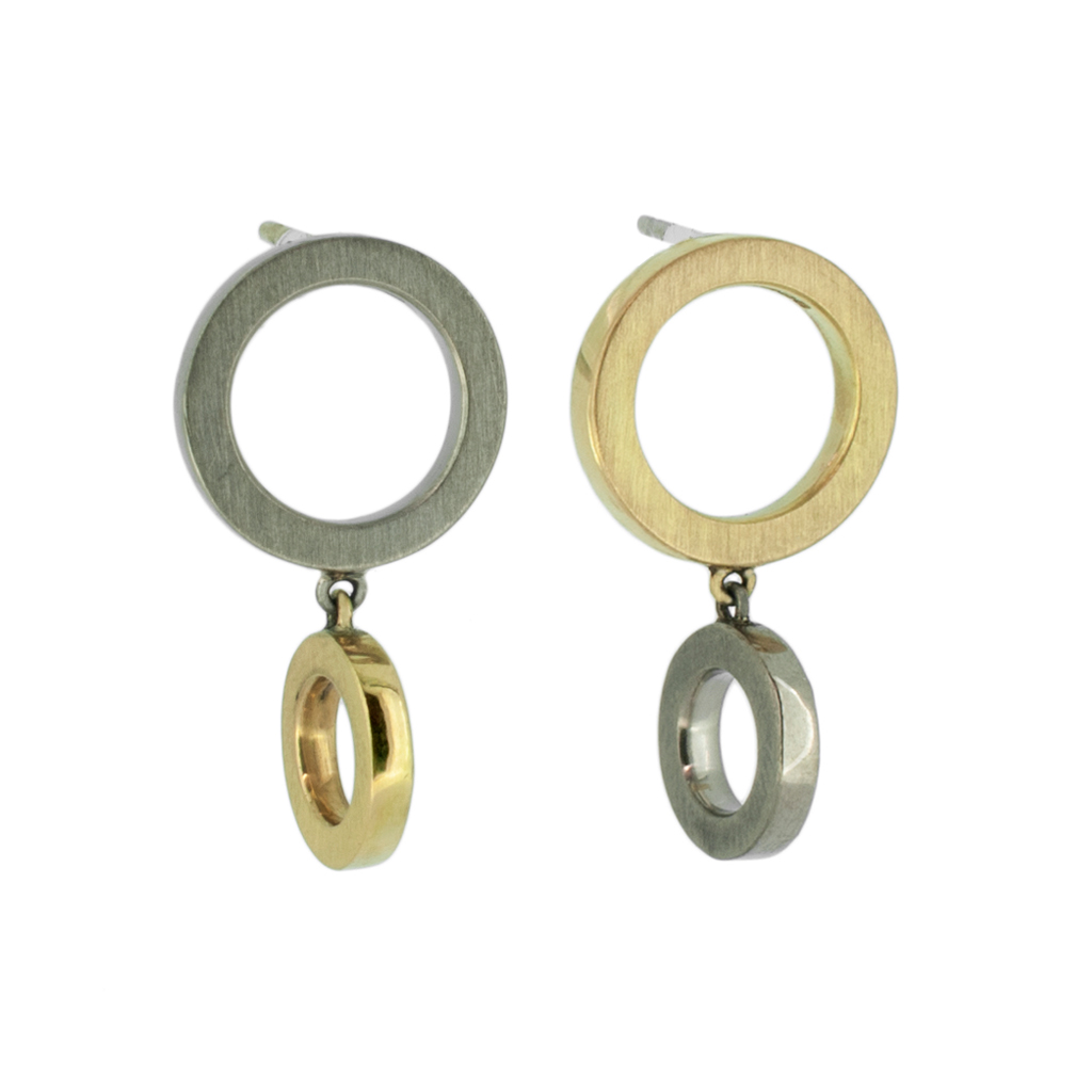 Two tone yellow and white gold earrings on a white background.