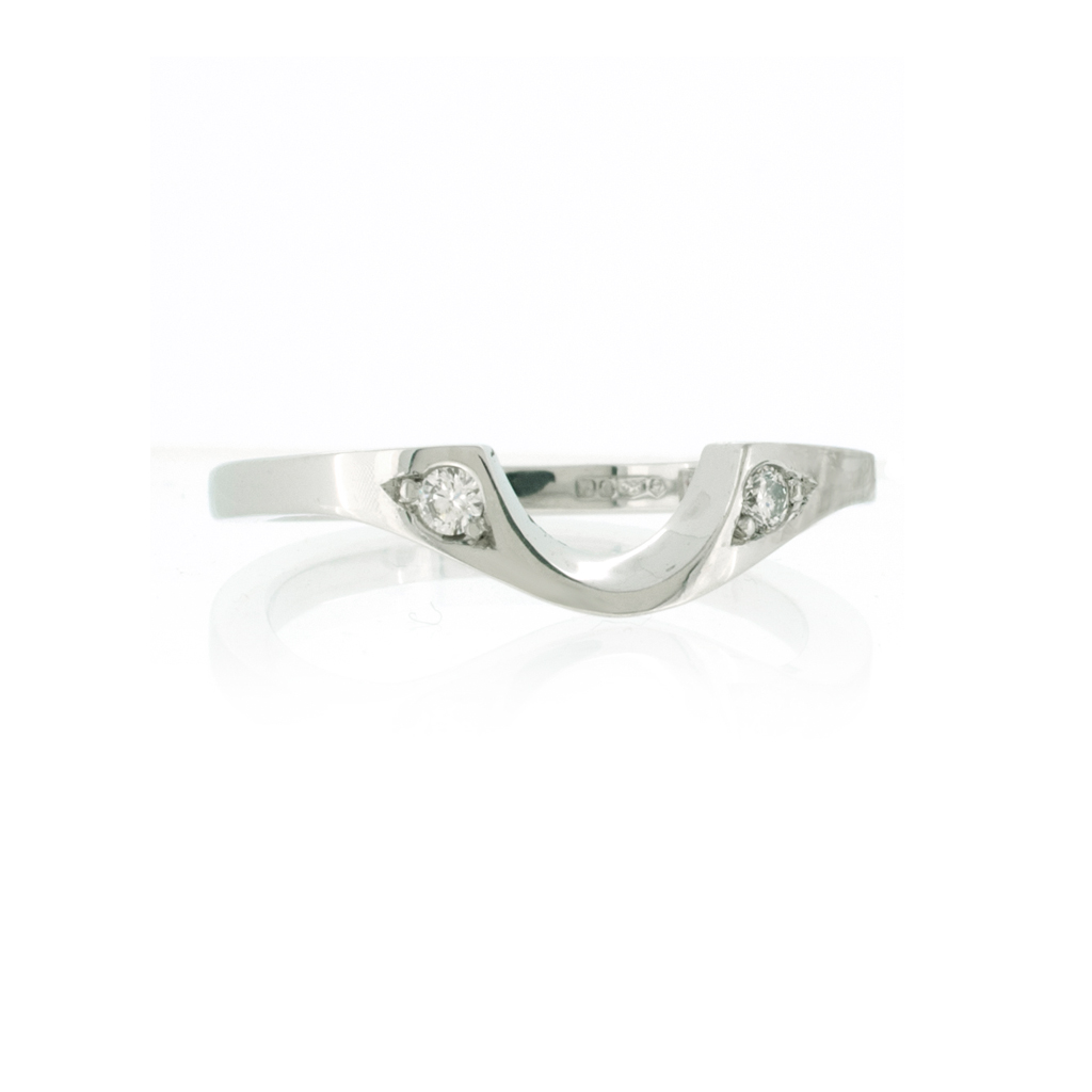 platinum wed-fit ring with ethical diamonds on white background