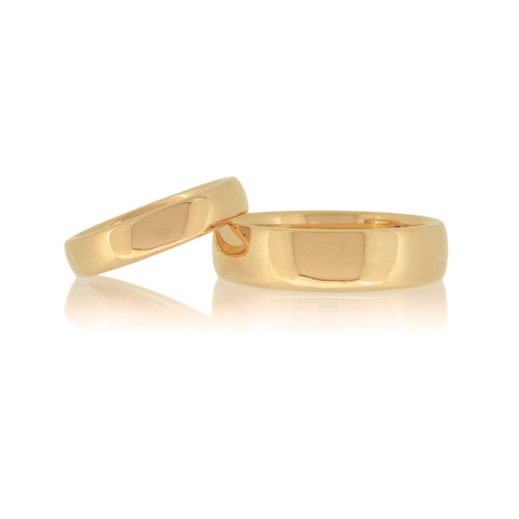 A pair of 22k wedding rings set against a white background.