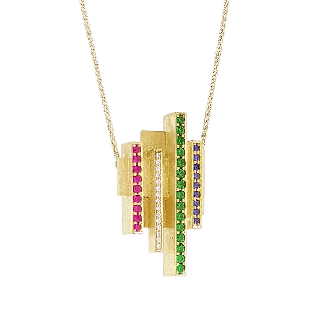 Yellow gold pendant hanging on a spiga chain with diamonds, rubies, sapphires, and tsavorites on a white background.