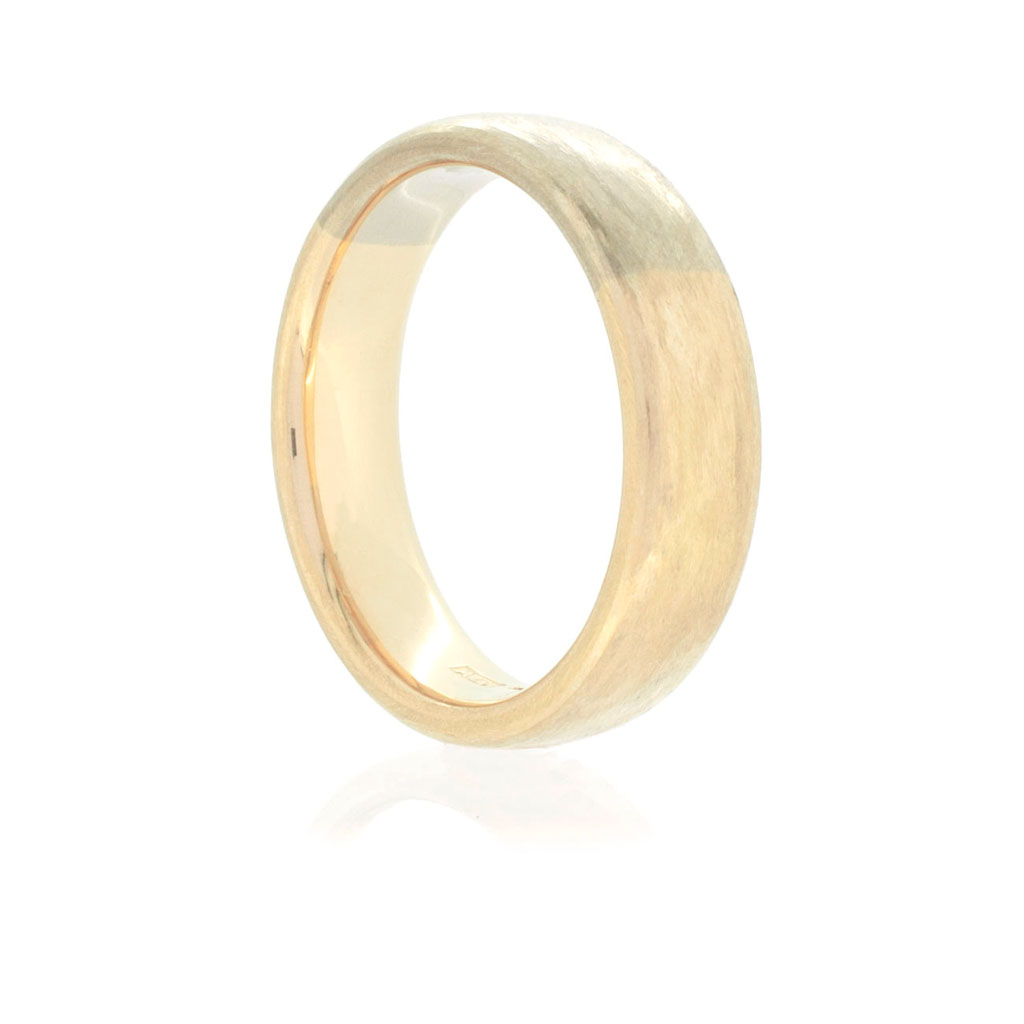 Two tone men's court band in 18k rose and white gold on a white background.