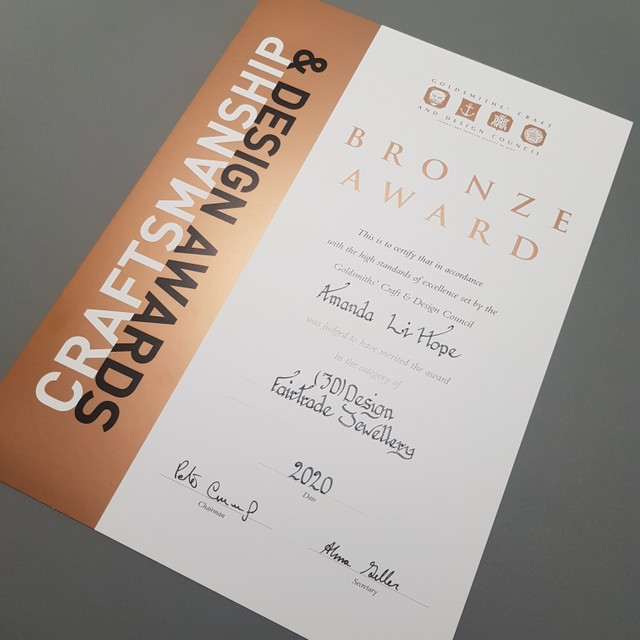 Bronze Award for Fairtrade Gold from the Goldsmiths' Craft & Design Council awards in 2020 for the Auroboros Necklace.
