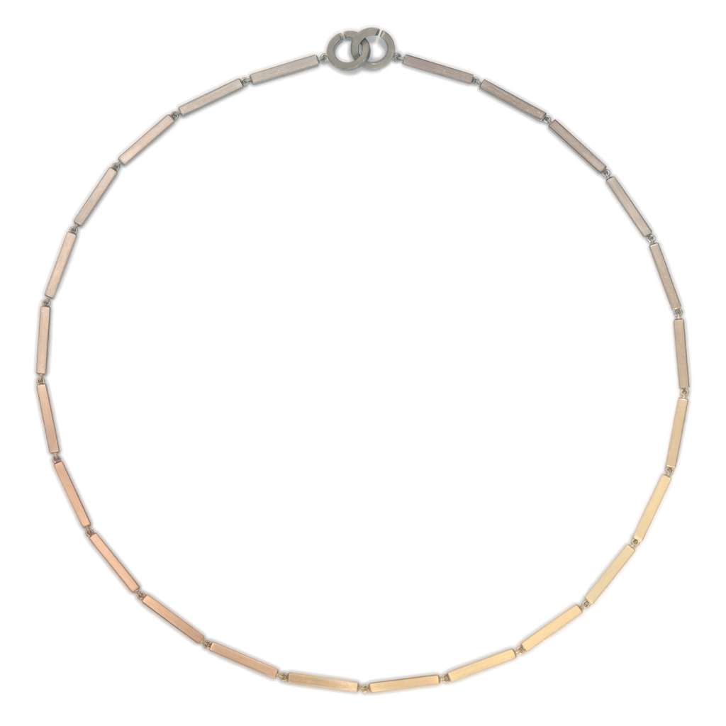 Auroboros bar link necklace on a white background