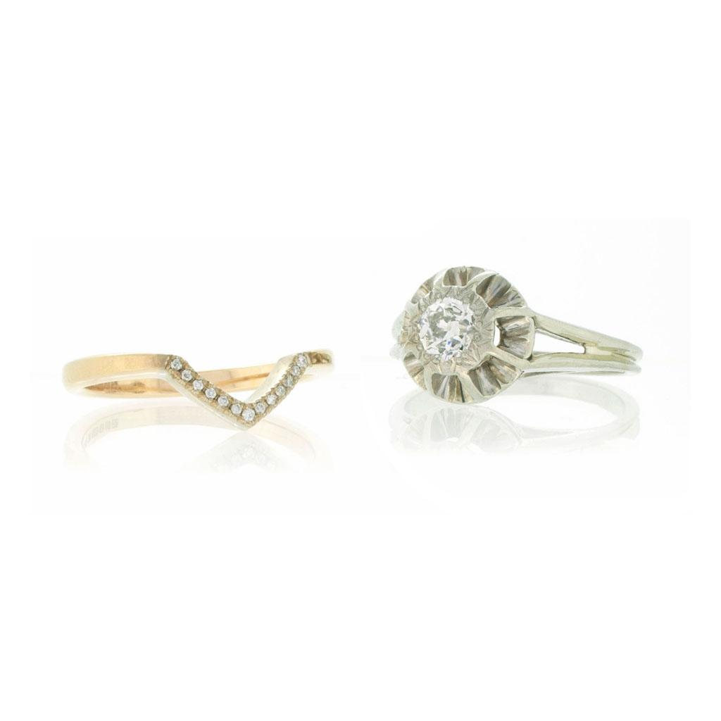Women's V-shaped diamond set wedding ring and vintage diamond engagement ring on a white background.