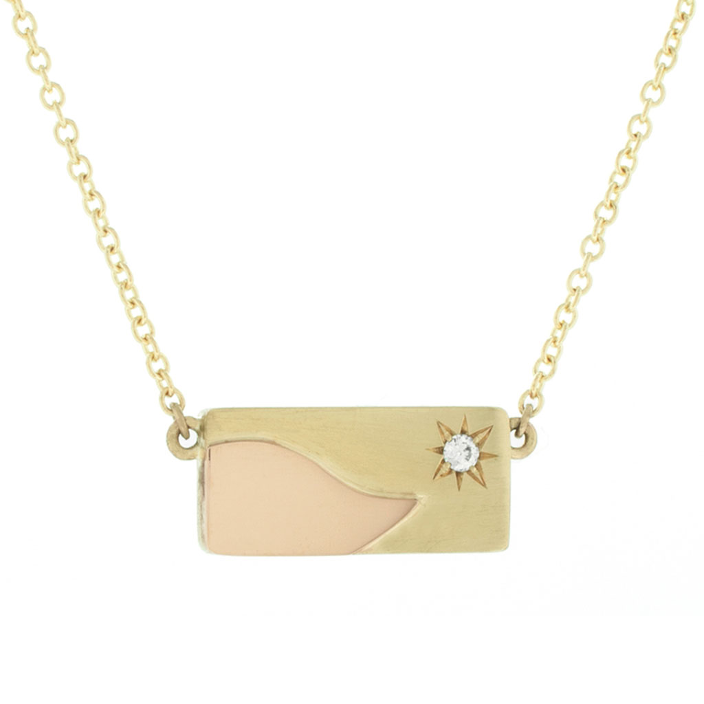 Rectangular memorial pendent in yellow gold with a rose gold and diamond hanging on a white background.