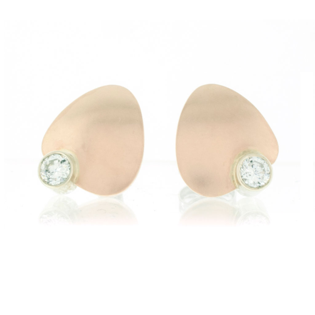 Petal shaped stud earrings in rose gold with diamonds set in contrasting white gold on white background.
