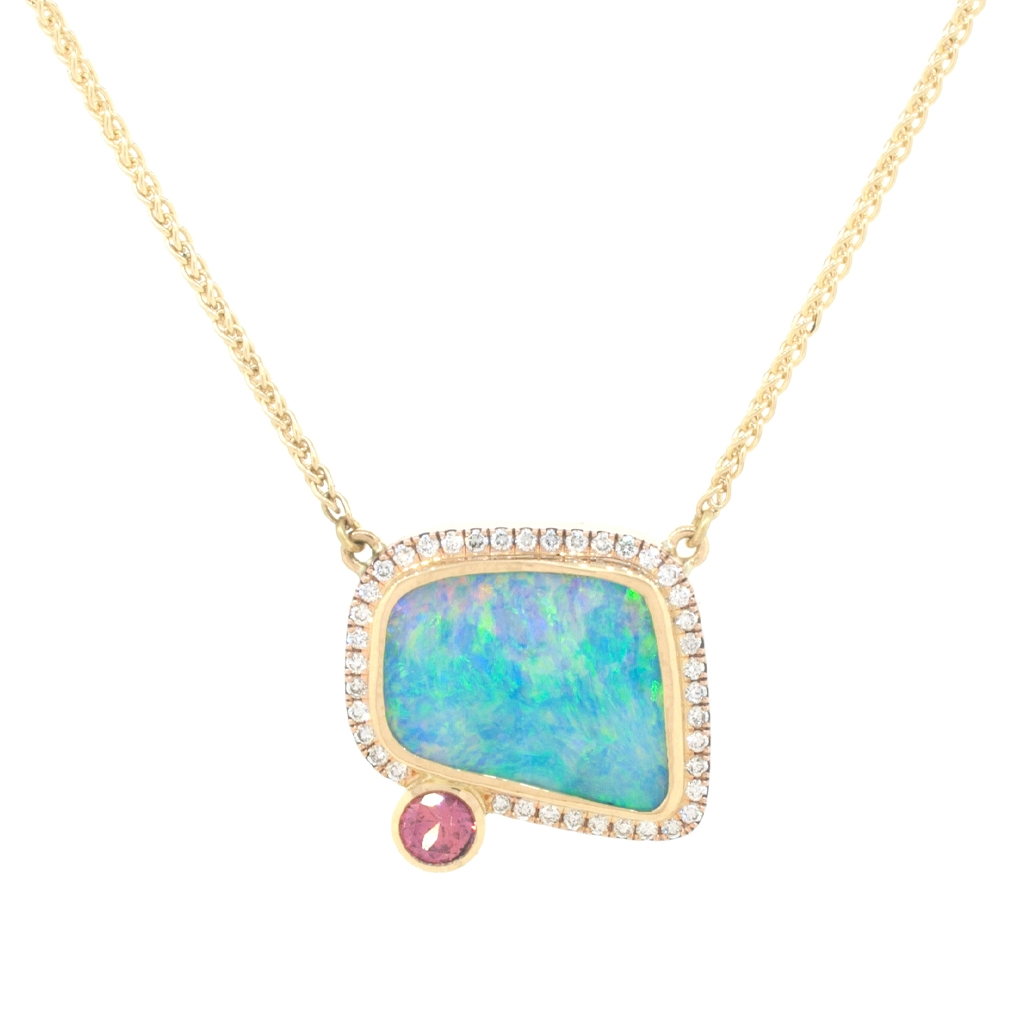 Boulder opal, diamond and padparadscha sapphire hanging on a gold chain on a white background.