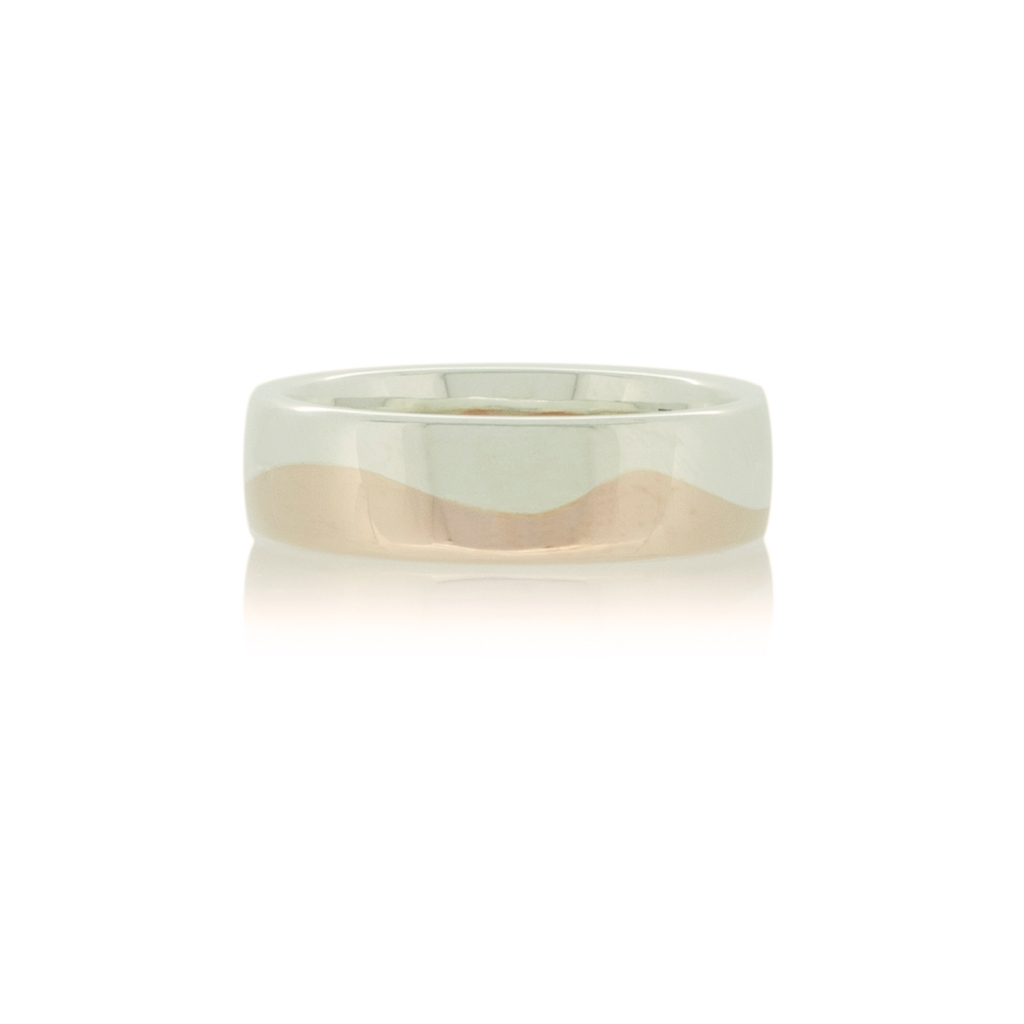 Silver and rose gold wedding band with wave design set against a white background.