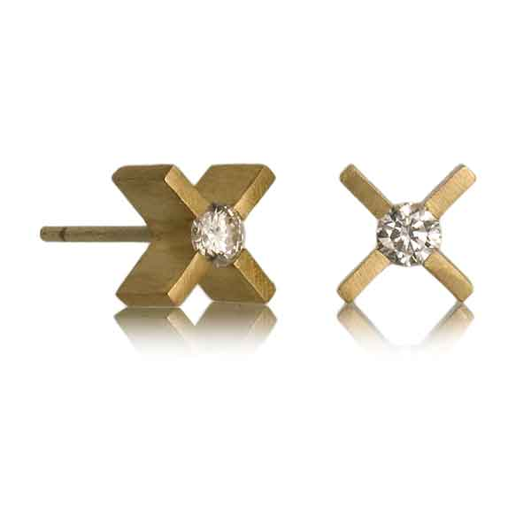 XX earrings in yellow gold with diamonds on a white background.