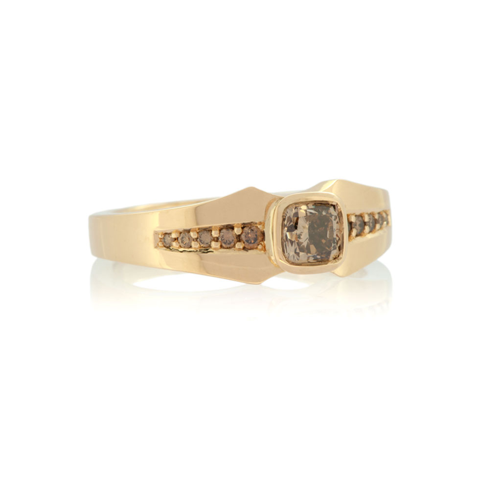 Front view of a light rose gold diamond ring with a tapering design set with a cushion cut champagne diamond and graduated champagne diamonds on a white background.